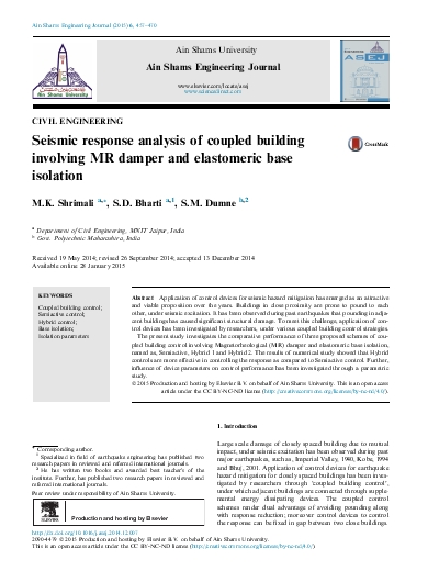 Seismic response analysis of coupled building involving MR damper and elastomeric base isolation